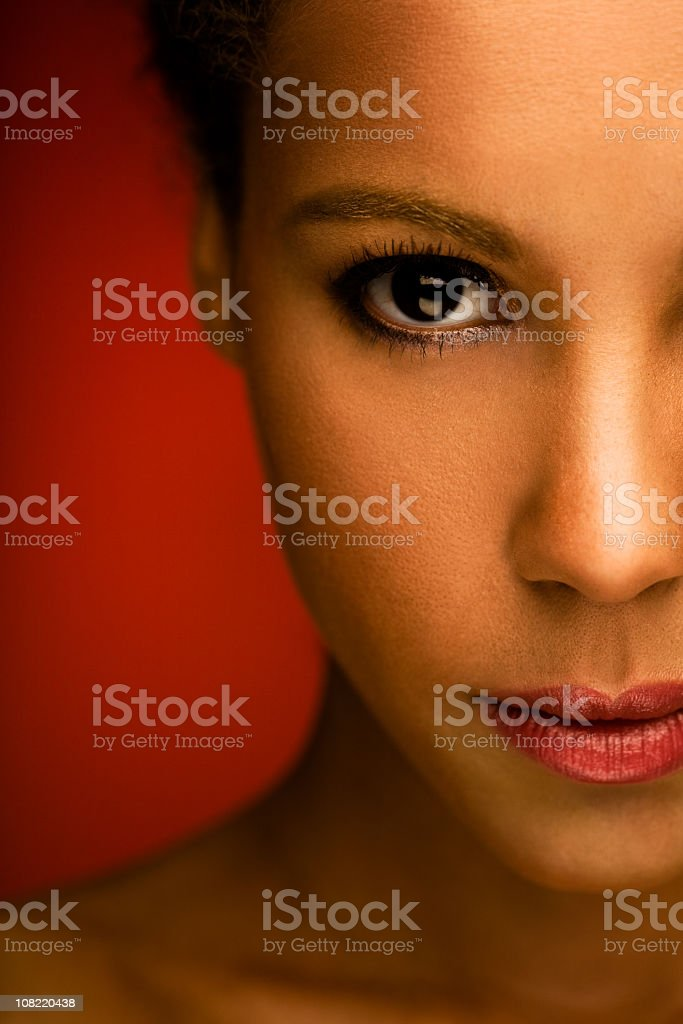 Portrait of Young Woman on Red Background royalty-free stock photo