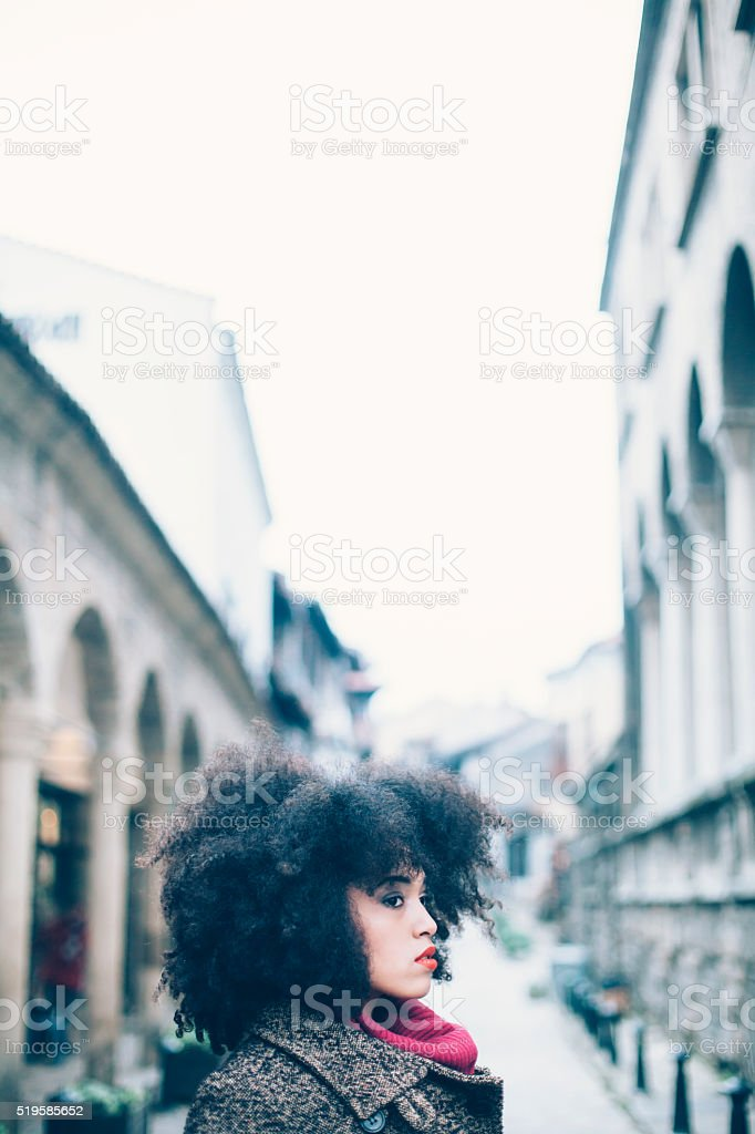 Portrait of young woman on street stock photo