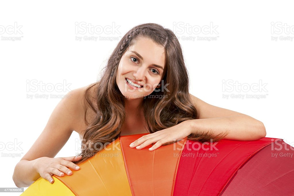 Portrait of young woman peeking over umbrella royalty-free stock photo