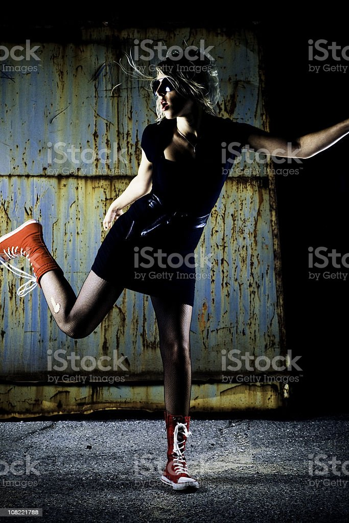 Portrait of Young Woman Posing Against Grunge Background royalty-free stock photo