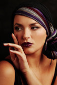 Portrait of Young Woman Posing Wearing Make-Up and Head Scarf