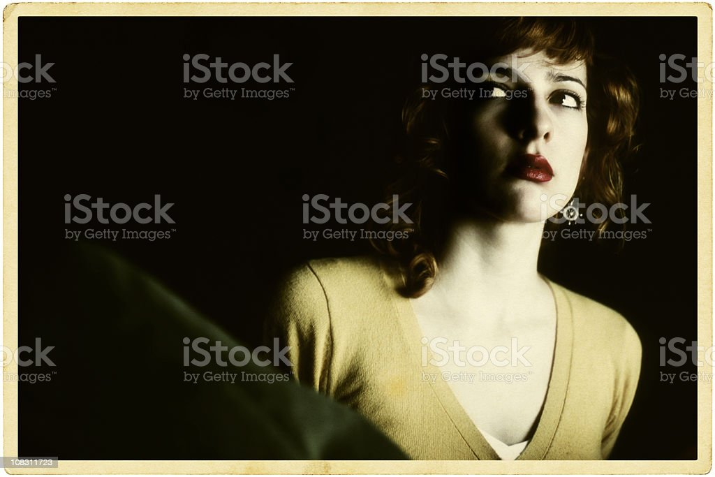 Portrait of Young Woman Pretending to Act in Hitchcock Movie stock photo