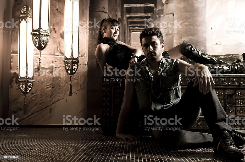 Portrait of Young Woman Reclining and Man Sitting on Floor royalty-free stock photo