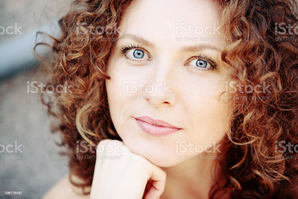 Portrait of Young Woman Resting Chin on Hand stock photo