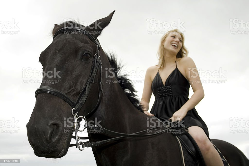 Portrait of Young Woman Riding Horse royalty-free stock photo