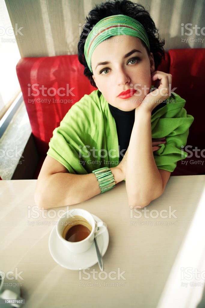 Portrait of Young Woman Sitting at Restaurant Drinking Coffee royalty-free stock photo