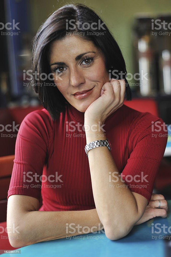 Portrait of young woman smiling at a cafe royalty-free stock photo