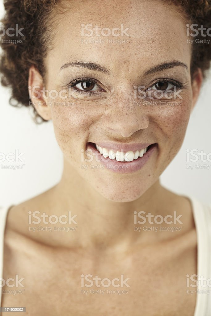 'Portrait of young woman smiling, close up' stock photo