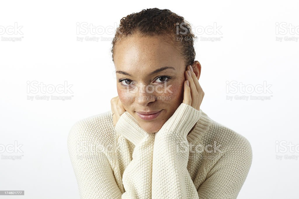 Portrait of young woman smiling in studio stock photo