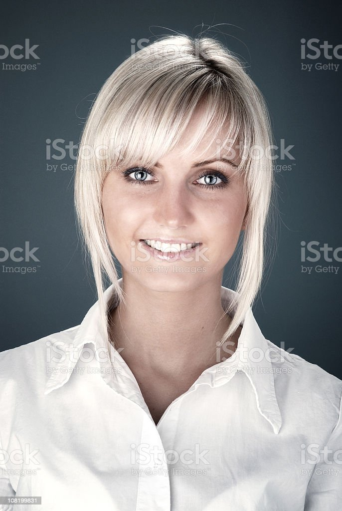 Portrait of Young Woman Smiling, Wearing Blouse royalty-free stock photo