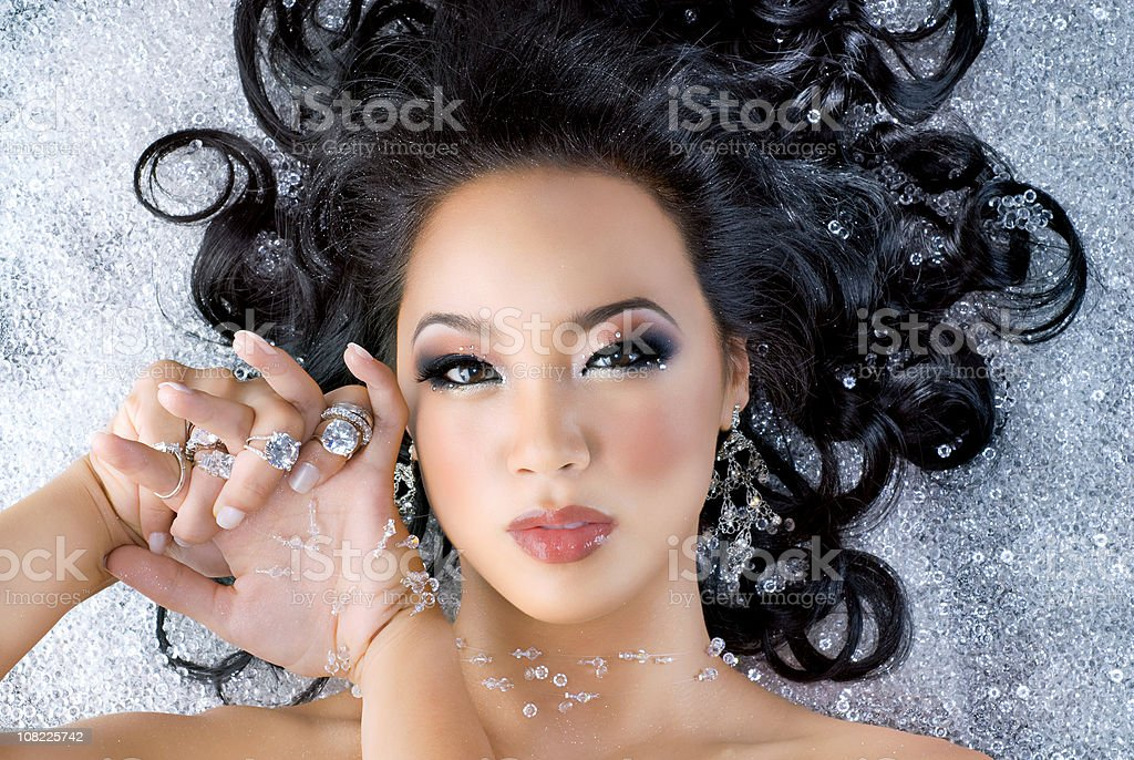 Portrait of Young Woman Surrounded by Diamonds royalty-free stock photo