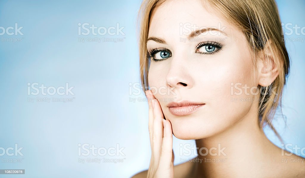 Portrait of Young Woman Touching Face, royalty-free stock photo