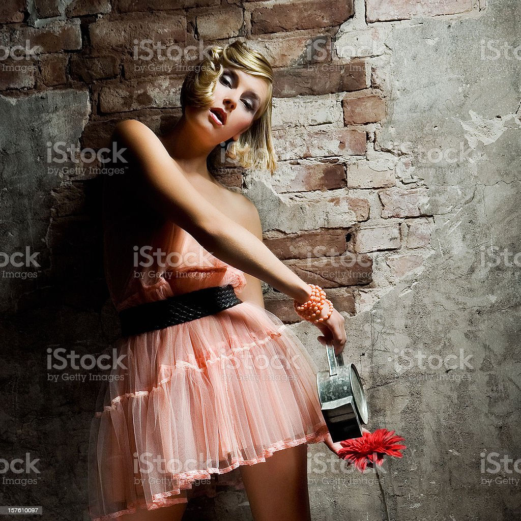 Portrait of Young Woman Water Flowering Indoors stock photo