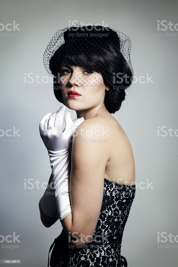 Portrait of Young Woman Wearing 1940's Style Clothing stock photo