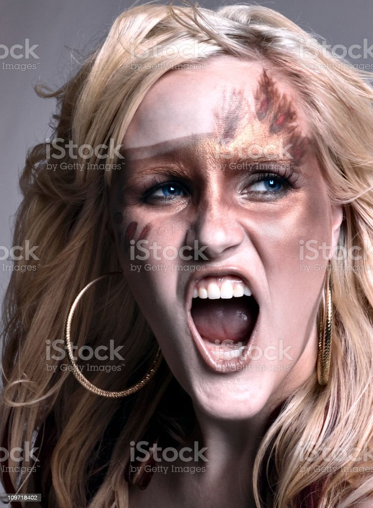 Portrait of Young Woman Wearing Bronze Face Paint stock photo