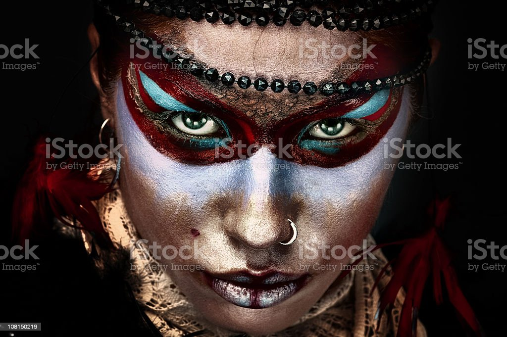 Portrait of Young Woman Wearing Face Paint Make-Up royalty-free stock photo