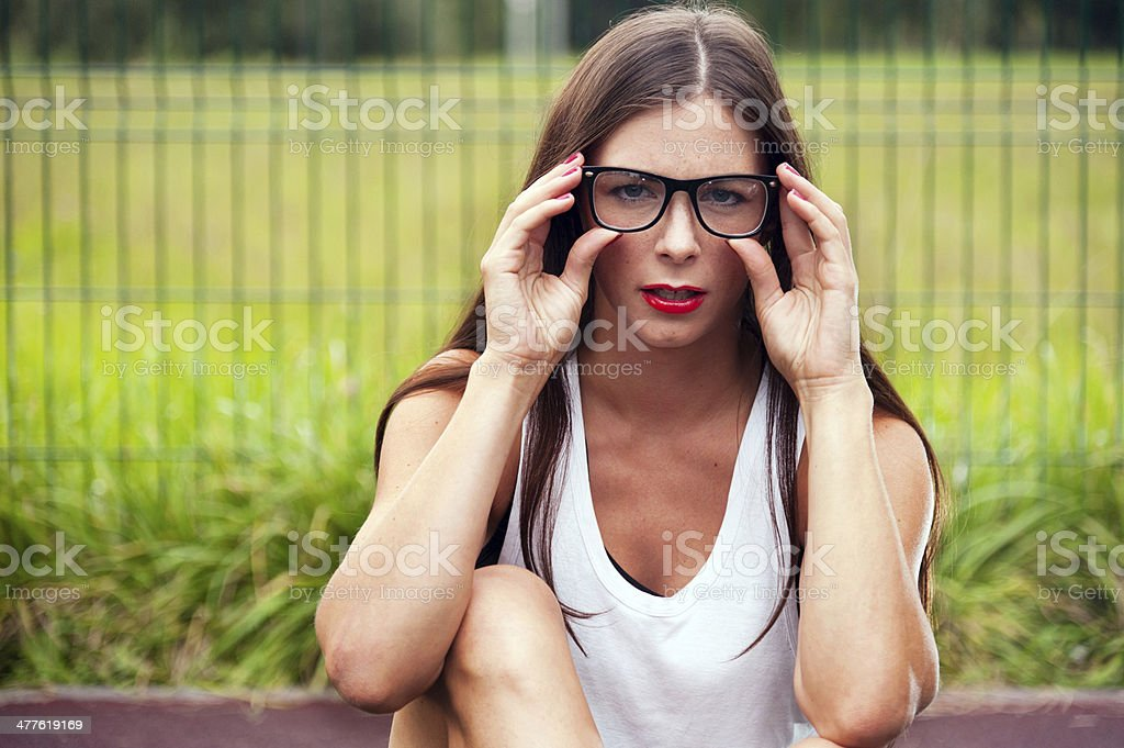 Portrait Of Young Woman Wearing Glasses On Playground royalty-free stock photo