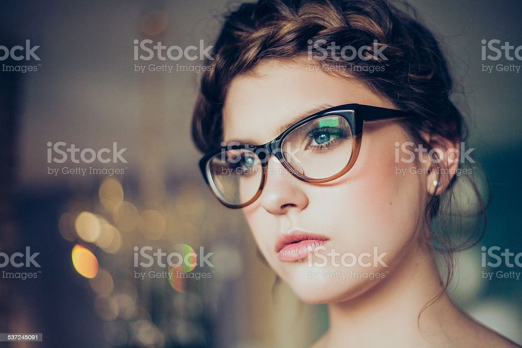 Portrait of young woman wearing glasses stock photo