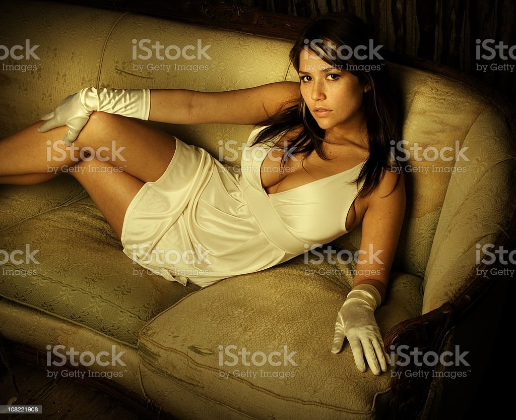 Portrait of Young Woman Wearing Gloves and Dress royalty-free stock photo