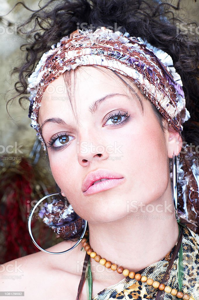 Portrait of Young Woman Wearing Headband and Earrings royalty-free stock photo