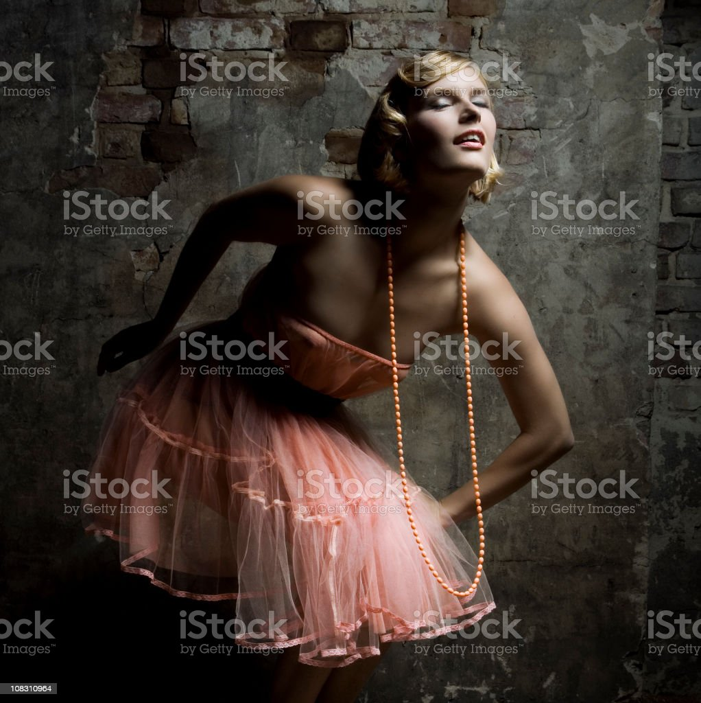 Portrait of Young Woman Wearing Long Pink Pearl Necklace royalty-free stock photo