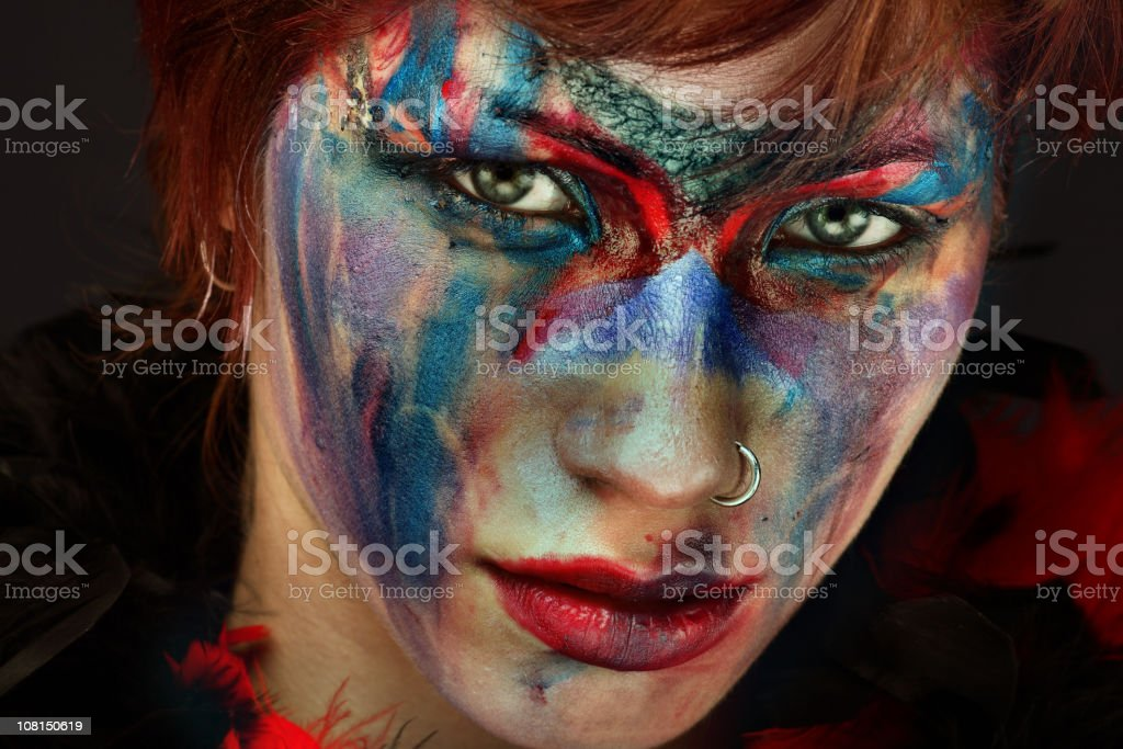 Portrait of Young Woman Wearing Messy Face Paint Make-Up stock photo