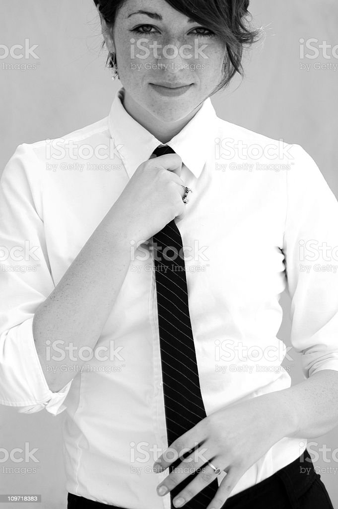 Portrait of Young Woman Wearing Necktie stock photo