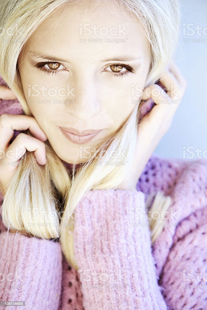Portrait of Young Woman Wearing Pink Sweater royalty-free stock photo