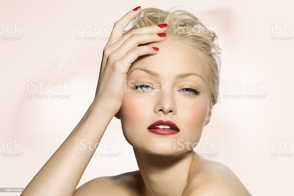Portrait of Young Woman Wearing Red Lipstick and Nail Polish royalty-free stock photo