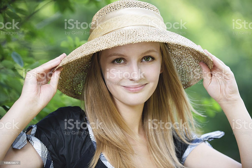 portrait of young woman wearing straw hat royalty-free stock photo