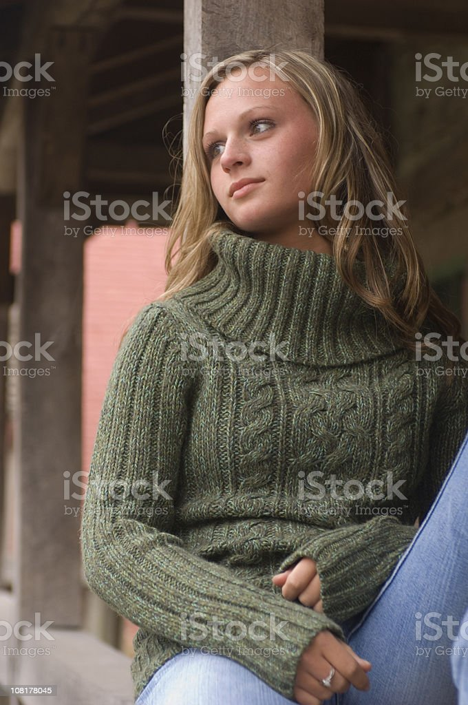 Portrait of Young Woman Wearing Sweater royalty-free stock photo