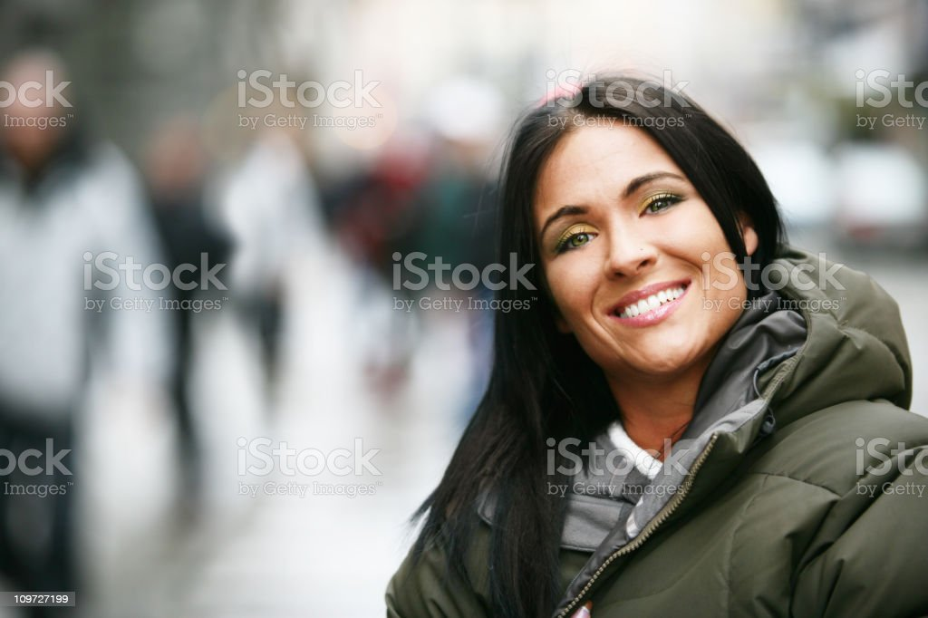 Portrait of Young Woman Wearing Winter Jacket Outside royalty-free stock photo