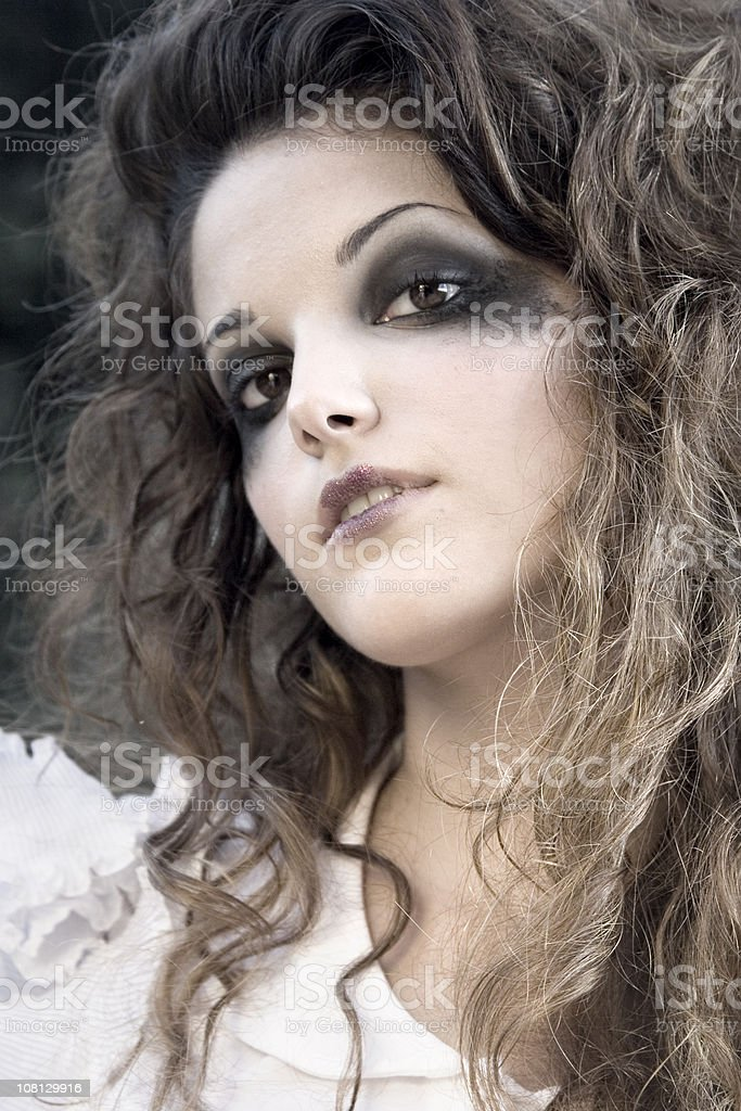 Portrait of Young Woman With Black Eye Make-up Smudged royalty-free stock photo