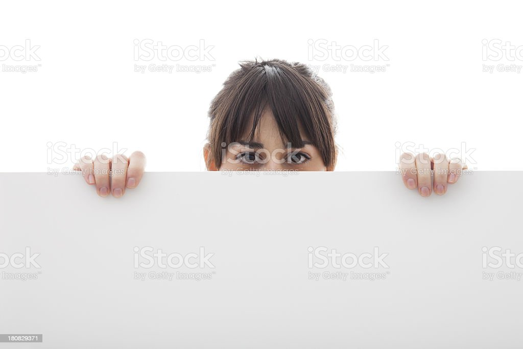 Portrait of young woman with blank billboard royalty-free stock photo