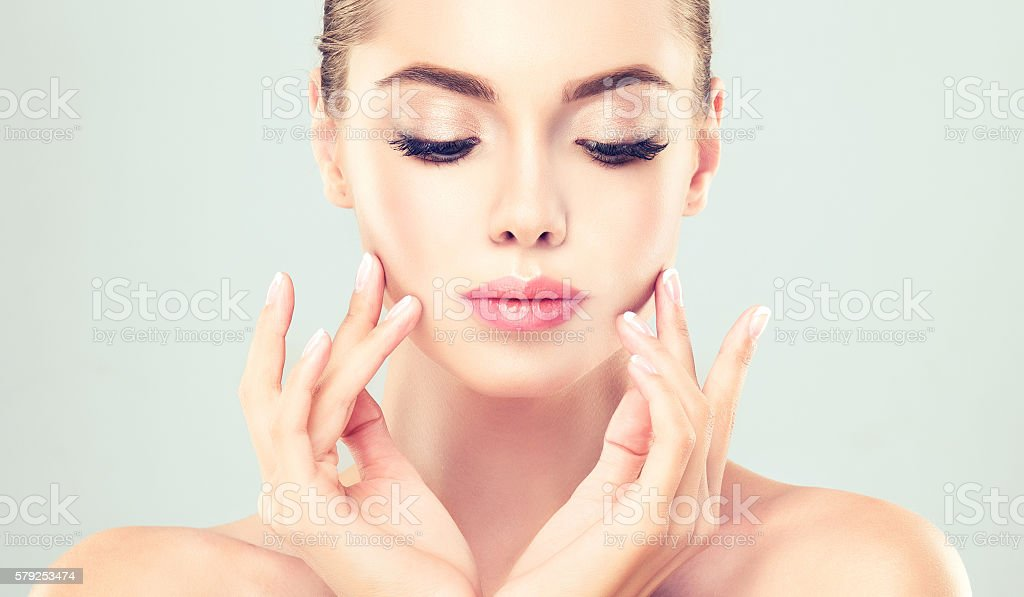 Portrait of young woman with clean fresh skin. stock photo