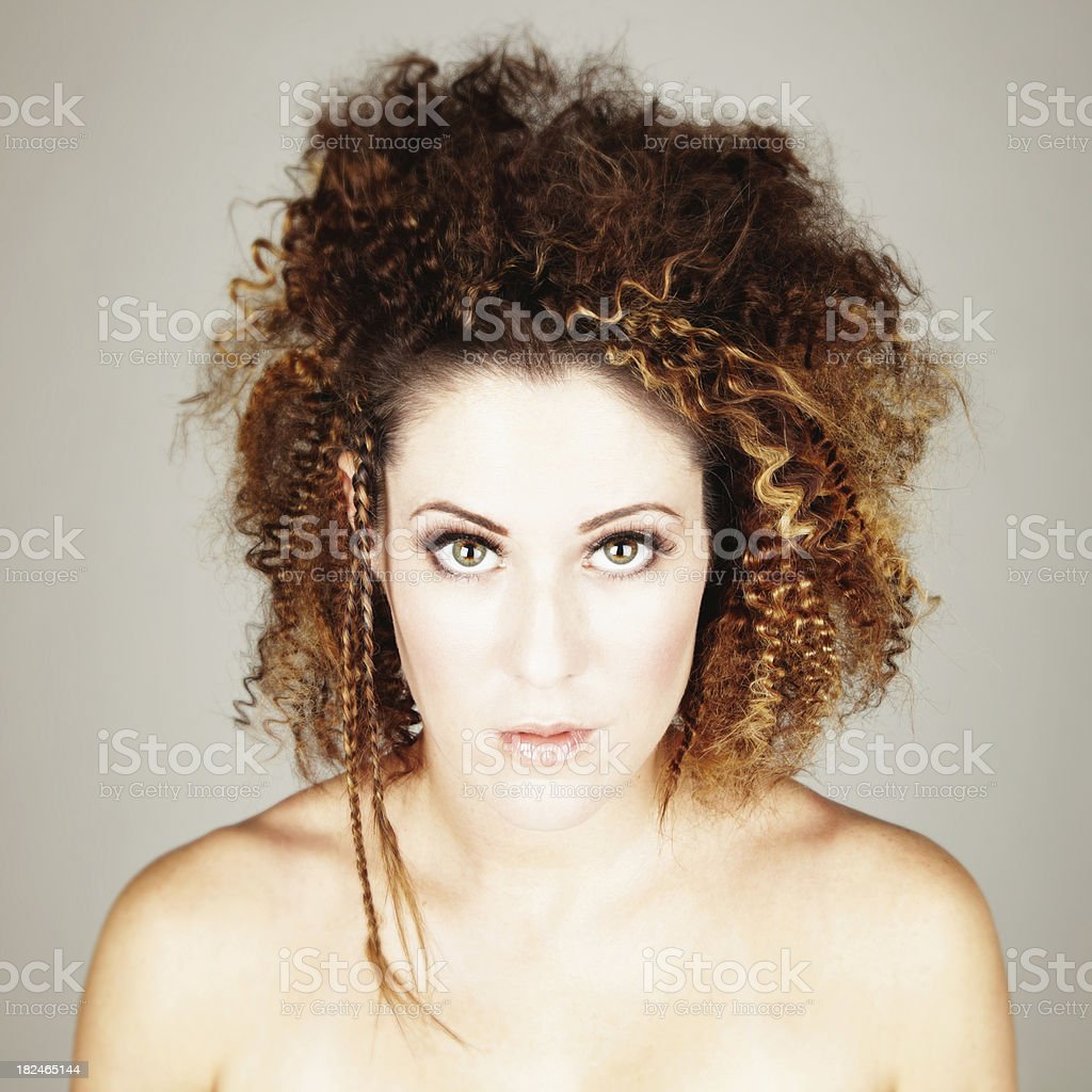 Portrait of Young Woman with Crimped, Braided Hairstyle royalty-free stock photo