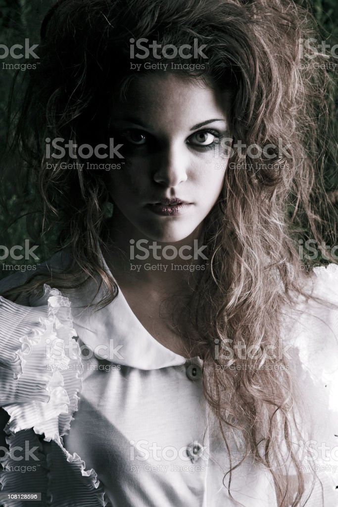 Portrait of Young Woman With Curly Hair and Smudged Make-up stock photo