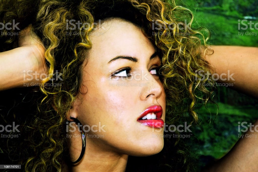 Portrait of Young Woman with Curly Hair stock photo