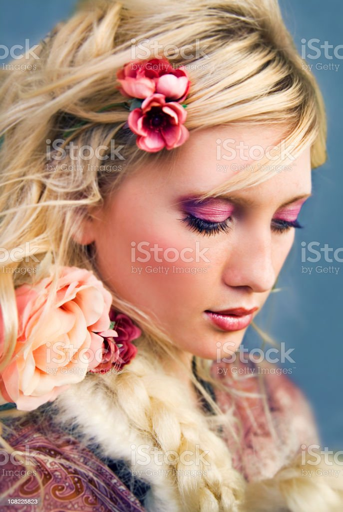 Portrait of Young Woman with Flowers in Hair royalty-free stock photo