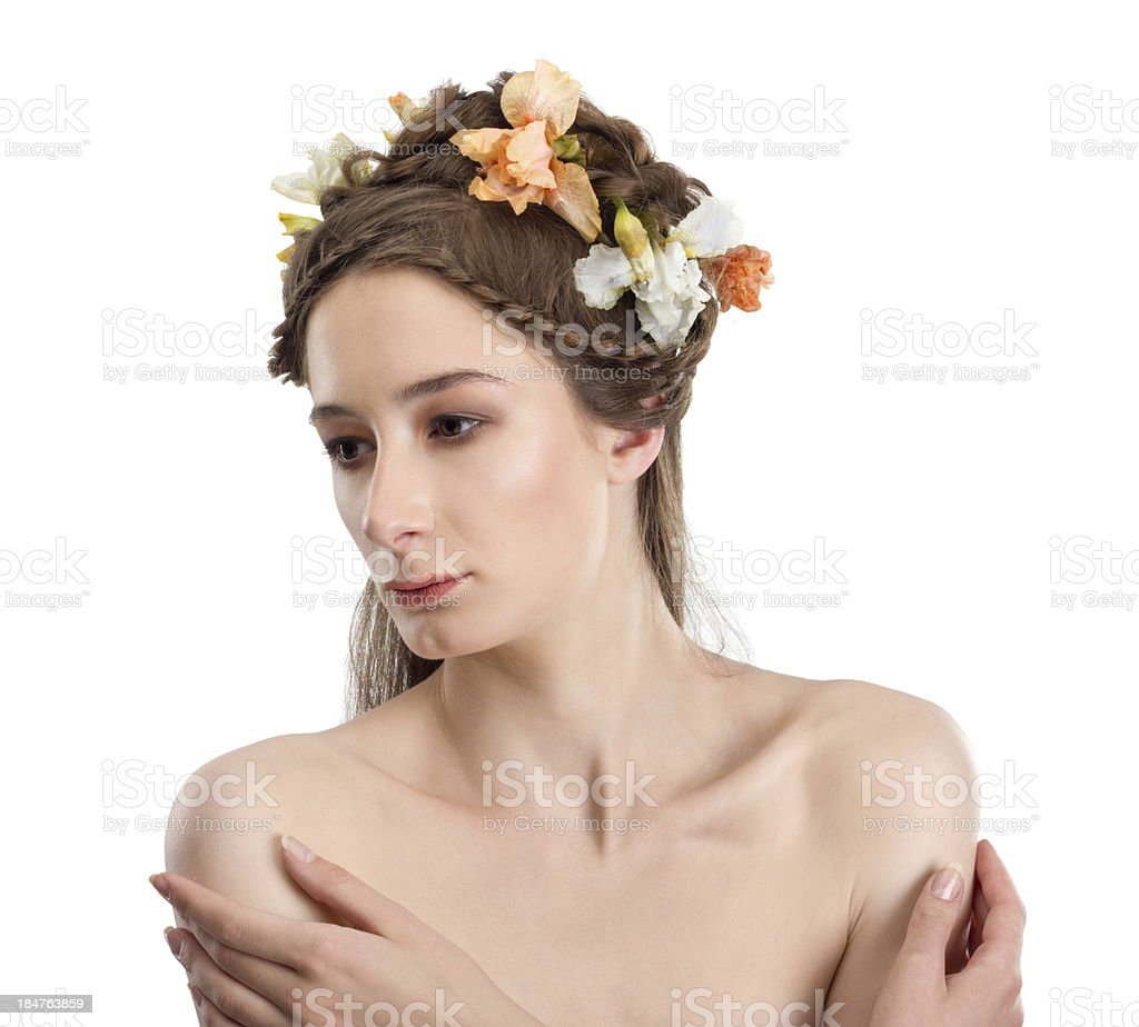 Portrait of young woman with flowers in her hair royalty-free stock photo