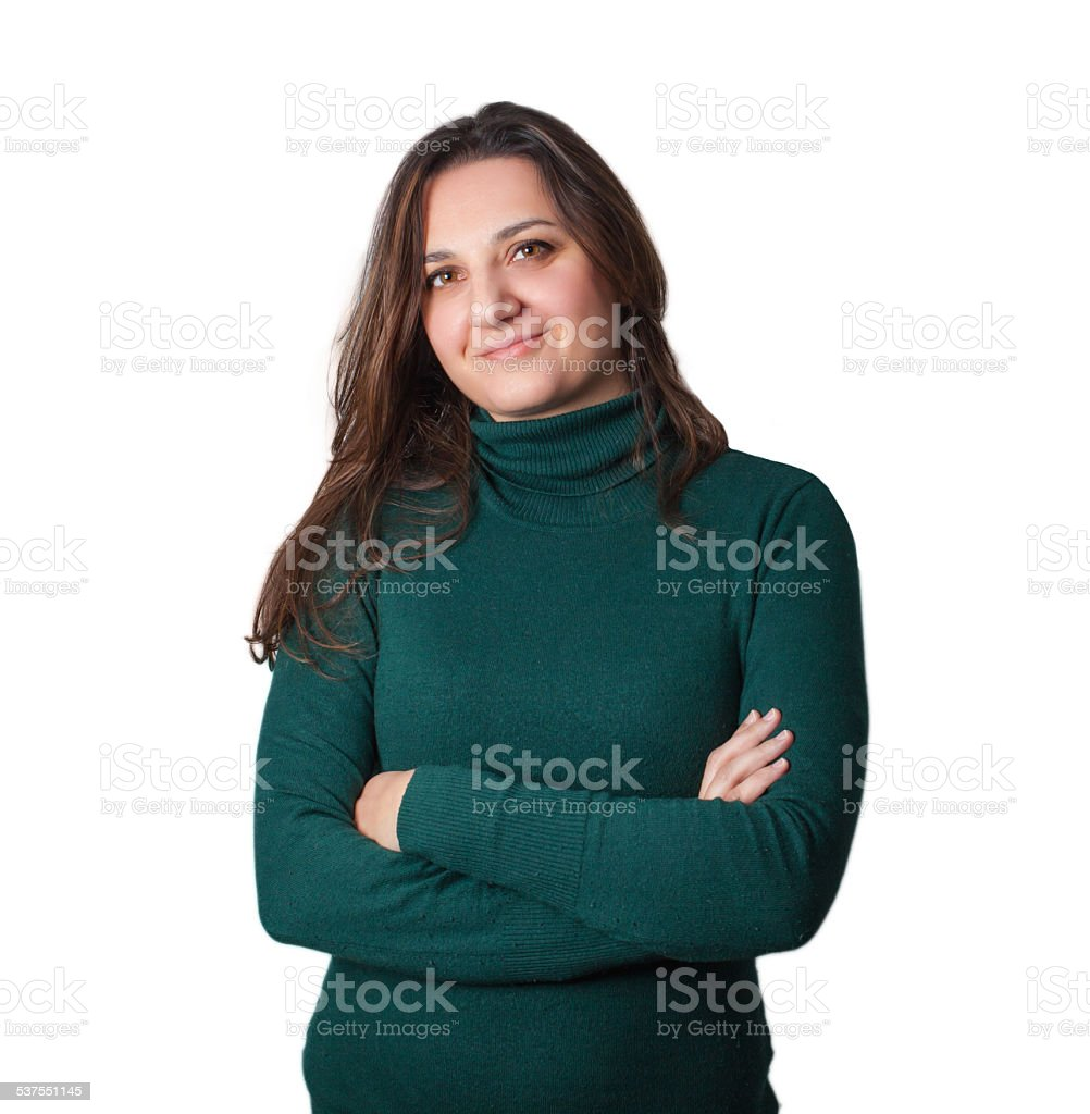 Portrait of young woman with folded arms. stock photo