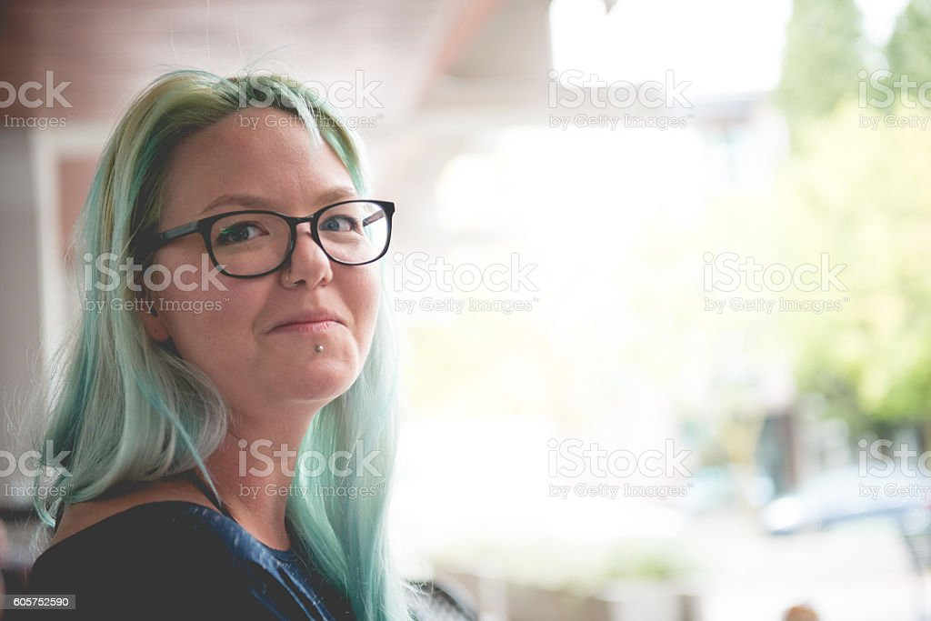 Portrait of Young Woman with Green Dyed Hair Downtown, Slovenia stock photo