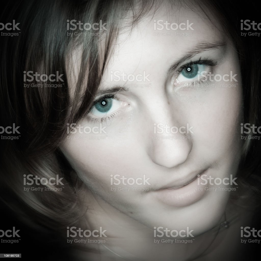 Portrait of Young Woman with Green Eyes stock photo