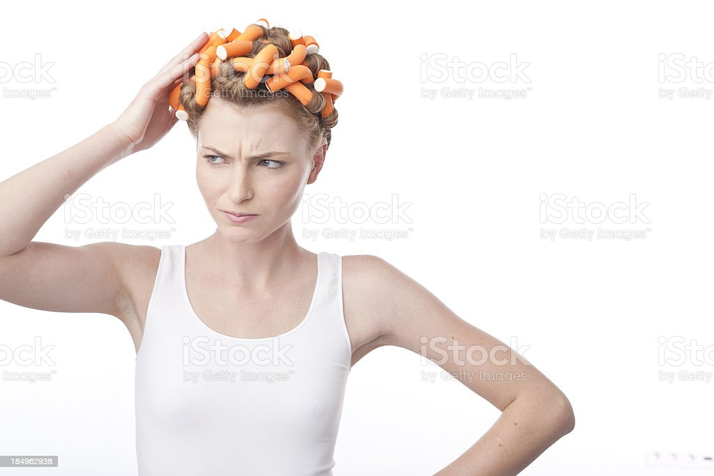 portrait of young woman with hair curlers stock photo