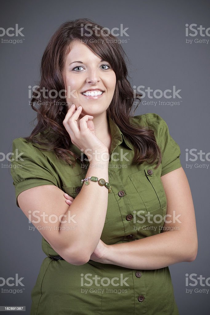 Portrait of Young Woman with Hand on Chin stock photo