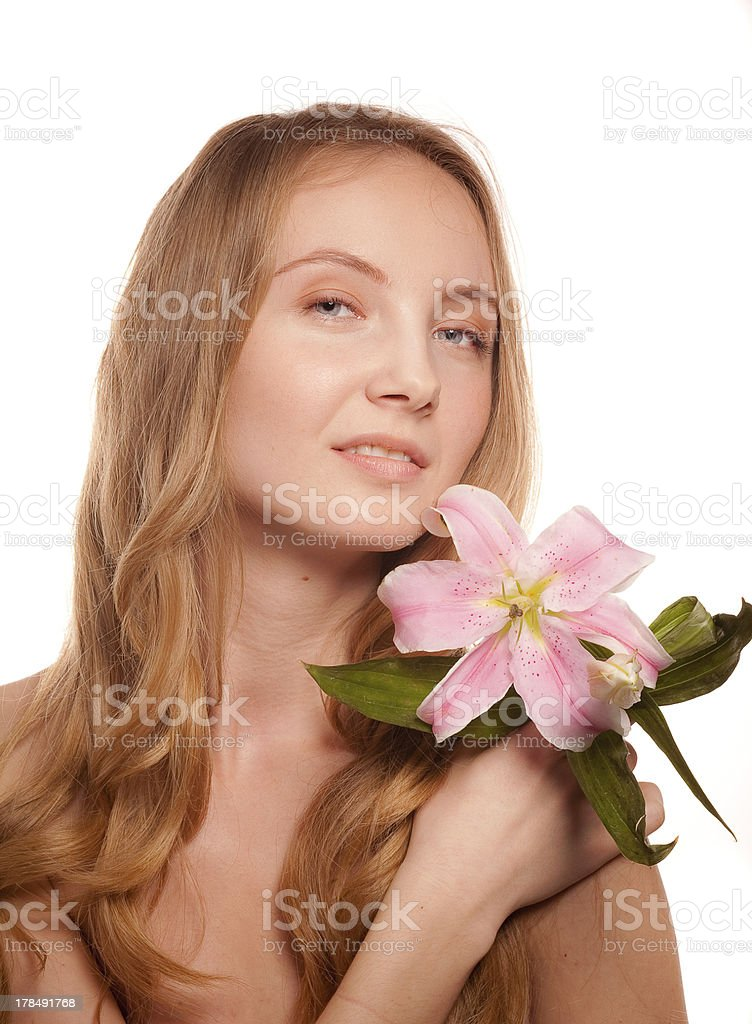 Portrait of young woman  with lily royalty-free stock photo