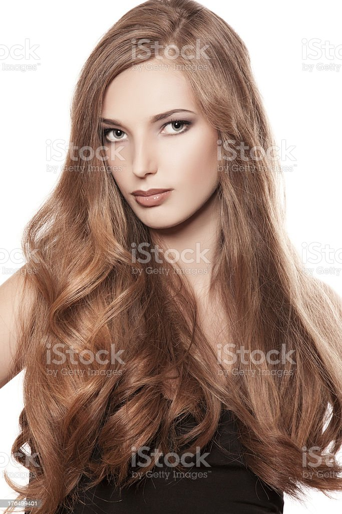 portrait of young woman with long curly hair royalty-free stock photo
