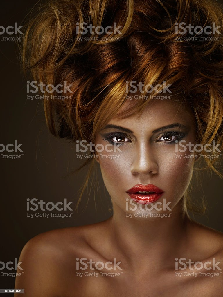 Portrait of young woman with lots of curly hair royalty-free stock photo