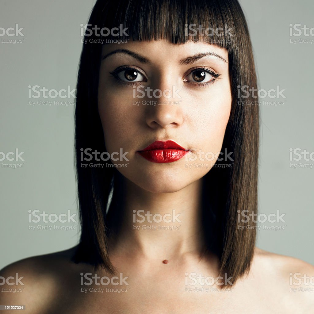 Portrait of young woman with red lipstick stock photo