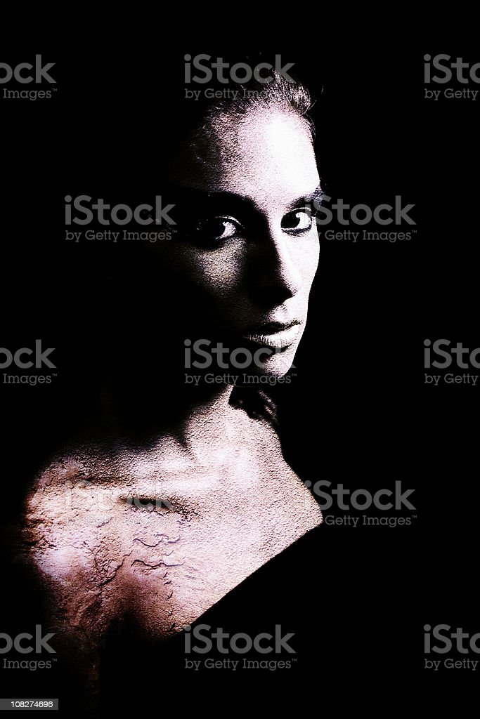 Portrait of Young Woman with Rock Texture Skin, High Contrast royalty-free stock photo